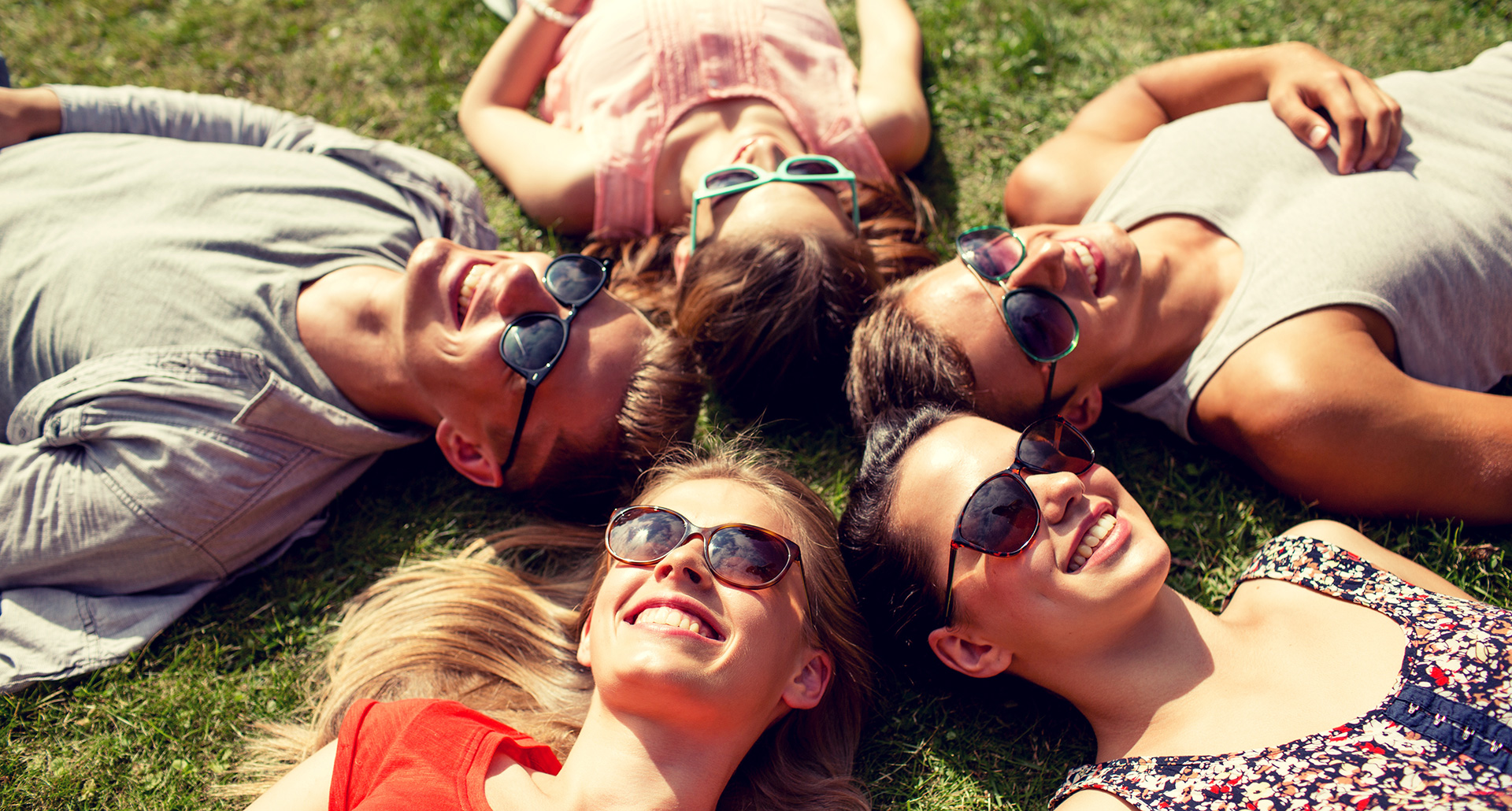 A group of friends lying on the grass